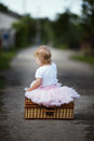 Cute little girl with suitcase back outdoors Stock Photography