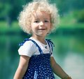 Cute little girl in summer park Royalty Free Stock Photo