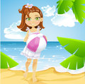 Cute little girl at the sunny beach with ball Royalty Free Stock Photography