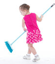 Cute little girl sweeps a floor isolated on white baby girlie lass female child lassie concept Stock Photography