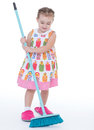 Cute little girl sweeps a floor isolated on white baby girlie lass female child lassie concept Stock Photo