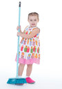 Cute little girl sweeps a floor isolated on white baby girlie lass female child lassie concept Royalty Free Stock Photography