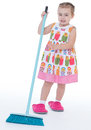 Cute little girl sweeps a floor isolated on white baby girlie lass female child lassie concept Stock Photos
