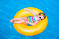 Cute little girl in swimming pool on inflatable ring child playing water vacation and traveling with kids children play outdoors Royalty Free Stock Photo