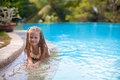 Cute little girl in the swimming pool looks at camera this image has attached release Stock Images
