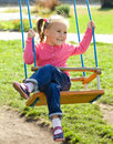 Cute little girl on swing Stock Images