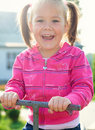 Cute little girl is swinging on see-saw Stock Photo