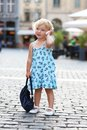 Cute little girl talking on mobile phone in the city Royalty Free Stock Photo