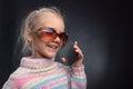 Cute little girl talks on phone Royalty Free Stock Photo