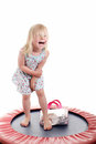 Cute little girl on a trampoline Stock Photography