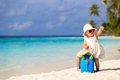 Cute little girl travel on summer beach Royalty Free Stock Photo