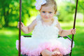 Cute little girl in tutu swinging at park Royalty Free Stock Photography