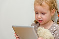 Cute little girl using tablet computer Stock Images