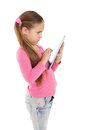 Cute little girl using tablet pc on white background Royalty Free Stock Photography