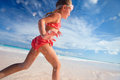 Cute little girl on vacation happy running and jumping at shallow water Royalty Free Stock Photography