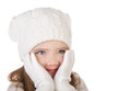Cute little girl in warm hat and gloves closing her cheks isolat Royalty Free Stock Photo