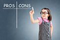 Cute little girl wearing business dress and writing pros and cons comparison concept blue background Stock Photos