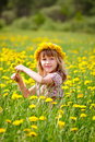 Cute little girl wearing floral wreath outdoors portrait of with dandelion enjoying a summer day Royalty Free Stock Photos