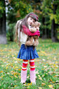 Cute little girl wearing fur coat in autumn forest Stock Image