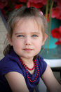 Cute little girl wearing red beads. Royalty Free Stock Image