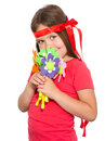 Cute little girl wit a bunch of flowers isolated over white Royalty Free Stock Photos