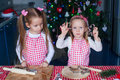 Cute little girls baking ginger cookies for christmas at kitchen this image has attached release Stock Image