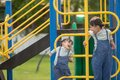 Cute little girls siblings having fun on playground outdoors on a sunny summer day. active sport leisure for kids Royalty Free Stock Photo