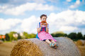 Cute little kid girl in traditional Bavarian costume in wheat field Royalty Free Stock Photo