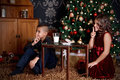 Cute little kids waiting for Santa Claus Royalty Free Stock Photo