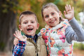 Cute little kids waving hello in the park Royalty Free Stock Photo