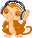 Cute little Monkey listening music Royalty Free Stock Photo