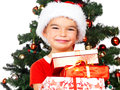 Cute little Santa girl holding gift boxes Royalty Free Stock Photo