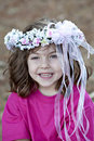 Cute little smiling gir with flowers in hairl Royalty Free Stock Images
