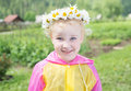 Cute little smiling girl in the chamomile wreath Royalty Free Stock Photo