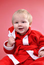 Cute little smiling Santa toddler boy Royalty Free Stock Photos