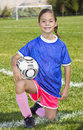 Cute little soccer player portrait a of a with the field and goal in the background Stock Photography
