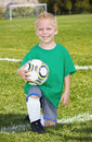 Cute little soccer player portrait a of a with the field and goal in the background Stock Images