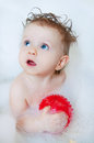 Cute little toddler girl taking a bath with bubbles Royalty Free Stock Photo