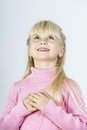 Cute little towhead girl waiting for miracle Royalty Free Stock Photo