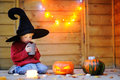 Cute little wizard looking on candle