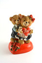 Cute lovers the figurine of two teddybears with hearts and roses Royalty Free Stock Photo