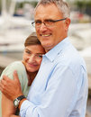 Cute mature couple hugging eachother outdoors Royalty Free Stock Images
