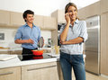 Cute mature couple preparing food enjoying themselves while Royalty Free Stock Photo