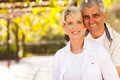 Cute mid age couple outdoors looking at the camera Royalty Free Stock Photography