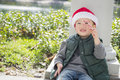 Cute Mixed Race Boy Wearing Santa Hat with Candy Cane Royalty Free Stock Photo