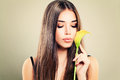 Cute Model Woman with Healthy Skin and Flowers