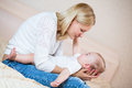 Cute mother playing with baby boy indoors Royalty Free Stock Photo