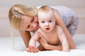 Cute mother playing with baby boy indoors Royalty Free Stock Photos