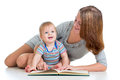 Cute mother reading a book to her baby boy Royalty Free Stock Images