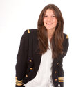 Cute navy officer young girl with a officers vest Stock Photos